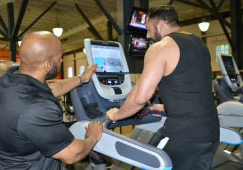 man doing treadmill with trainer